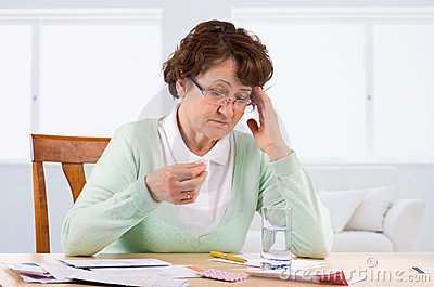 Elderly woman worry about bill notice