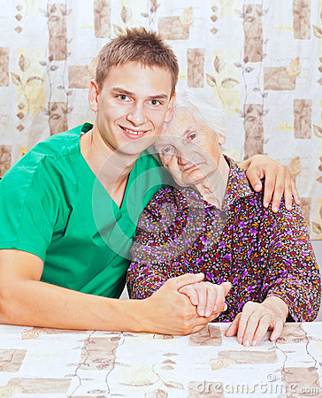 Elderly woman with the young smileing doctor