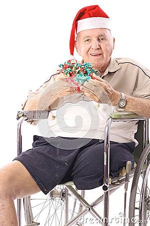 Eldery man in wheelchair celebrating christmas ver
