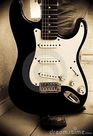 Electric guitar with guitarist