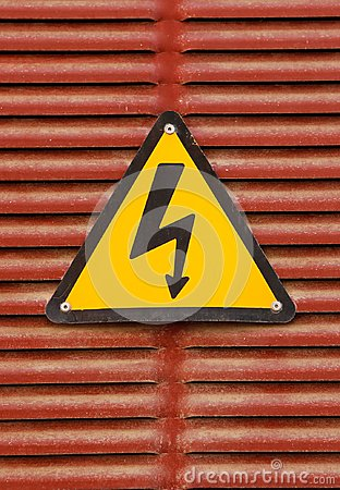 Free Electric Hazard Advert Sign On A Red Metal Wall Background Stock Image - 104771511