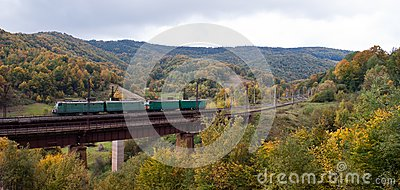 Electric locomotives on the bridge in mountains