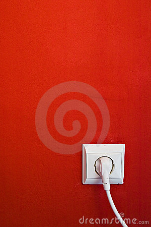 Electric outlet on red wall