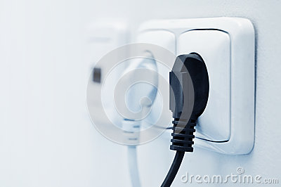 Electric plug in a socket