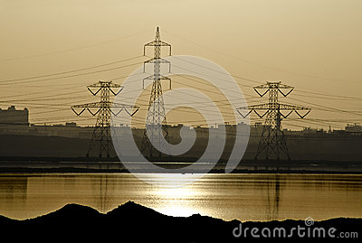 Electric Power Distribution Towers at Sunset