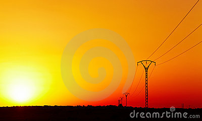 Electric power line against colorful sky at sunset