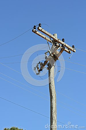 Free Electric Power Transmission Pole Made From Raw Tree Trunk Stock Photo - 100800130