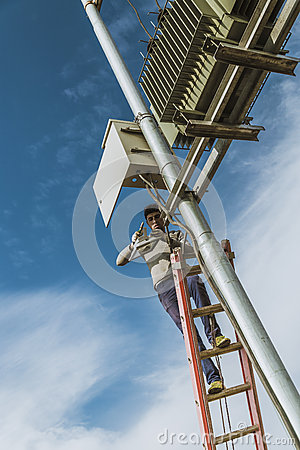 Free Electricain Repairing Power Transformer Stock Image - 70198171