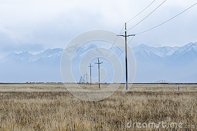 Electrical lines and pillars across the plain of upper Tibet Stock Photo