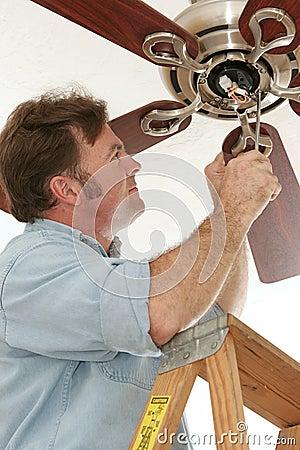 Free Electrician Installing Ceiling Fan Stock Image - 1286831