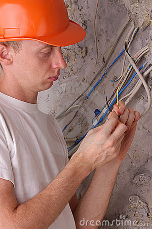 Electrician insulating the electric wires