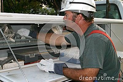 Electrician Reaching in Truck