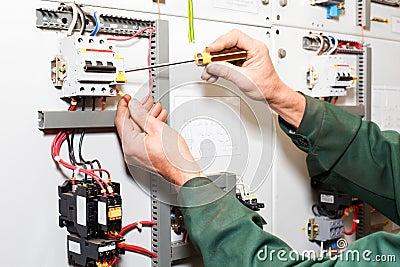 Electrician`s hands working