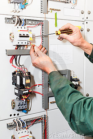 Electrician`s hands working