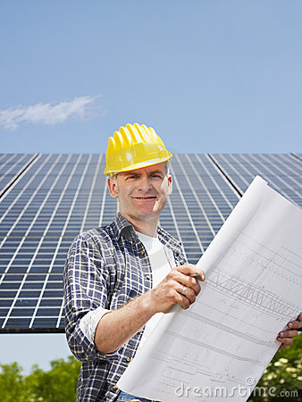 Free Electrician Standing Near Solar Panels Royalty Free Stock Images - 14532139