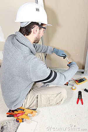 Electrician wiring a room