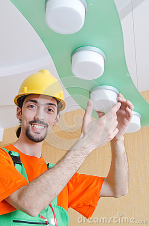 Electrician working on cabling