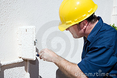 Electrician Working in Electrical Box