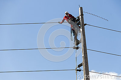 Electricians working on a pylon