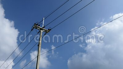 Electricity poles and transmission lines are in the sky. Electricity poles and transmission lines are in the midst of a rapidly moving cloud stock video