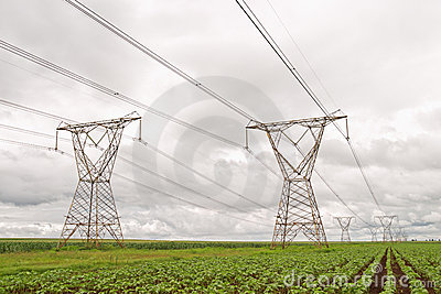 Electricity pylons against a stormy sky