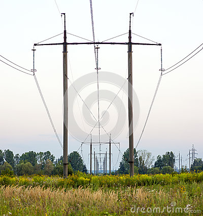 Free Electricity Pylons Trailing Away In Field. Power-transmission Po Royalty Free Stock Image - 88906286