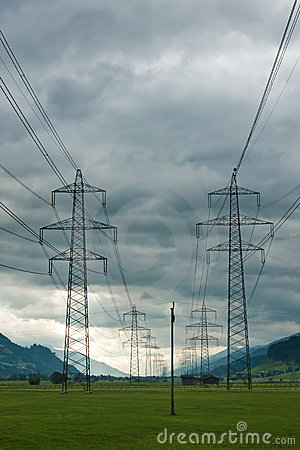 Electricity towers and cabels on cloud background