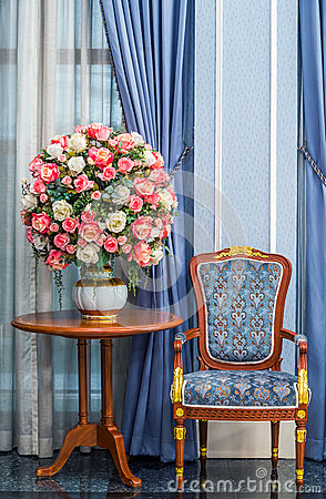 Elegance armchair with beautiful flower bouquet