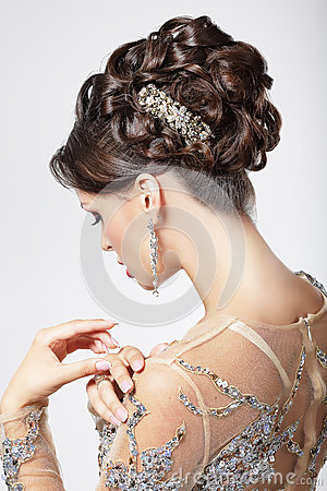 Elegance and Chic. Beautiful Brunette with Classy Hairstyle. Luxury