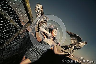 Elegance lady holding eagles