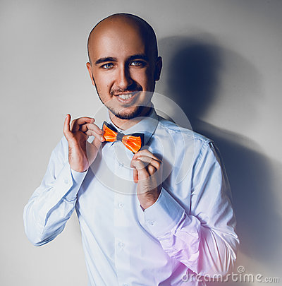 Elegance man in shirt and bowtie smiling on camera