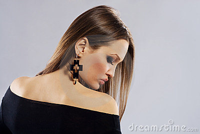 Elegance woman with cross shape earring