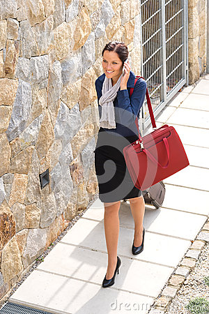 Elegance woman leaving home luggage calling phone