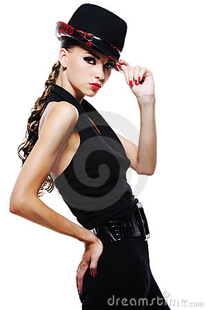Elegant adult girl in black with stylish black hat