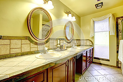 Elegant bathroom with stone wall trim