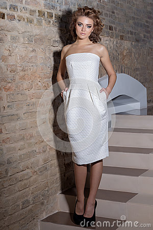 Free Elegant Beautiful Sexy Girl With Beautiful Hairstyle And Bright Evening Make-up In The Evening White Dress And Black Shoes , Fashi Stock Images - 62233144