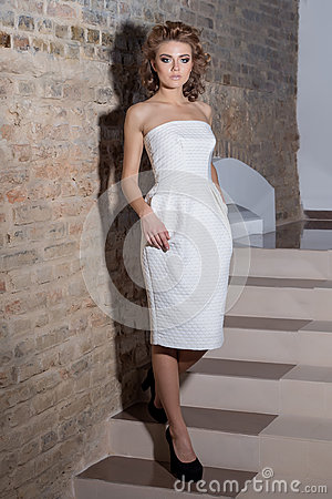 Free Elegant Beautiful Sexy Girl With Beautiful Hairstyle And Bright Evening Make-up In The Evening White Dress And Black Shoes , Fashi Stock Images - 62233174