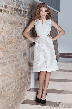 Free Elegant Beautiful Sexy Girl With Beautiful Hairstyle And Bright Evening Make-up In The Evening White Dress And Black Shoes , Fashi Stock Photography - 62233742