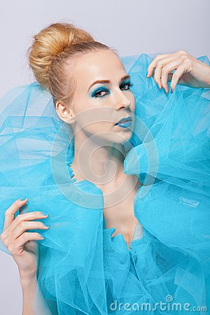Elegant beautiful woman in a blue gauze ruff