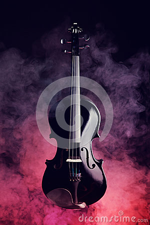 Elegant black violin in smoke