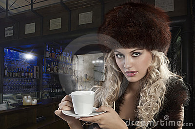 Elegant blond girl with cup of tea