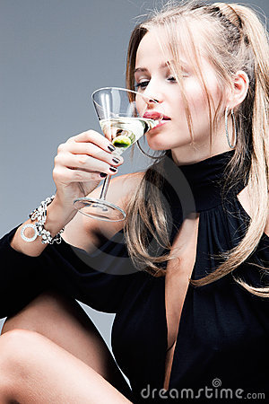 elegant blond woman drink martini coctail
