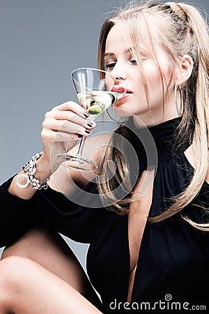 elegant blond woman drink martini coctail