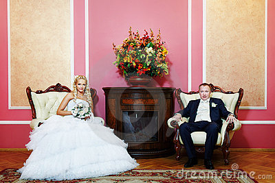 Elegant bride and groom in wedding palace