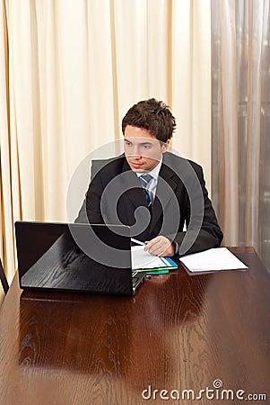 Elegant business man in office