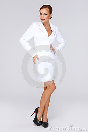 Elegant businesswoman in a white suit