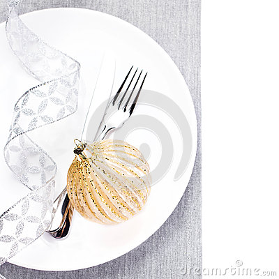 Elegant Christmas table setting with festive decorations on whit