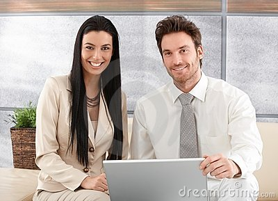 Elegant couple browsing internet at home smiling Stock Photo
