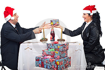 Elegant couple sharing Christmas gift
