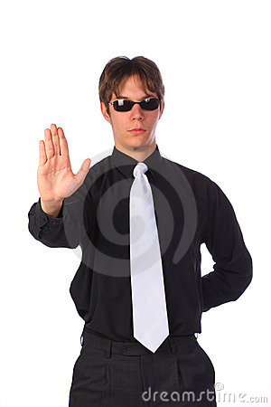 Elegant determined young businessman showing stop